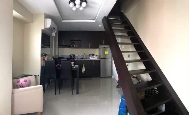 Condo unit (loft type) 2BR w/ mini walk in closet  Furnished & space for entertainment