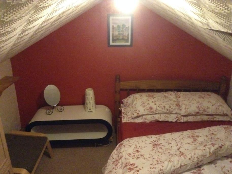 Attic bedroom, double bed.