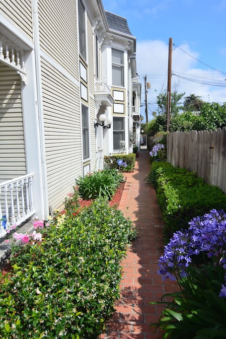 Flower-lined pathway to Unit #3 and garage