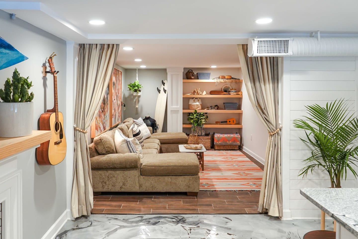 This cozy adventure shack offers coastal and outdoor-inspired living in a city setting. Complete with a living room, kitchen, two bedrooms, and an oversized bathroom, you'll have everything you need for an ideal stay.