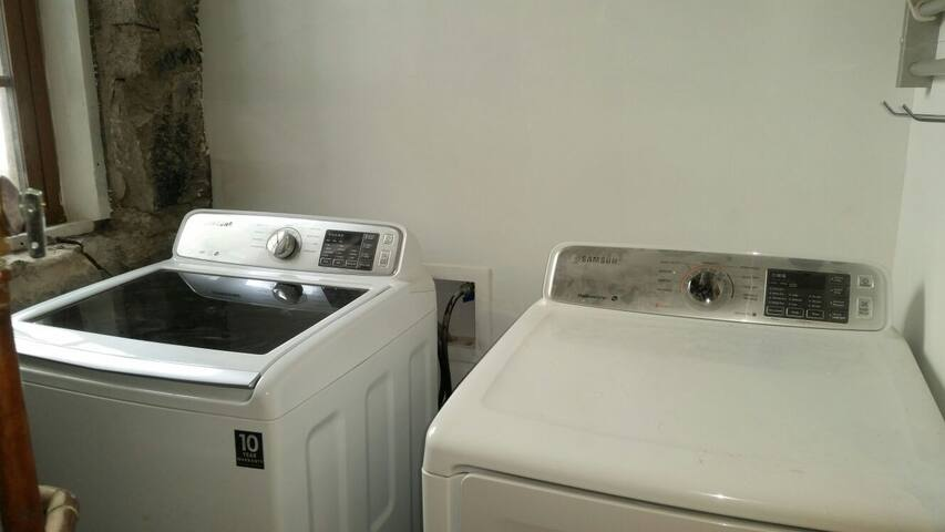 Private, full sized washer and dryer.  There is also an iron and small ironing board located here.