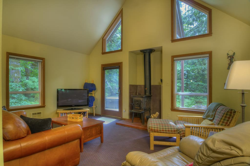 Comfortable living space with wood stove for cozy mountain ambiance.