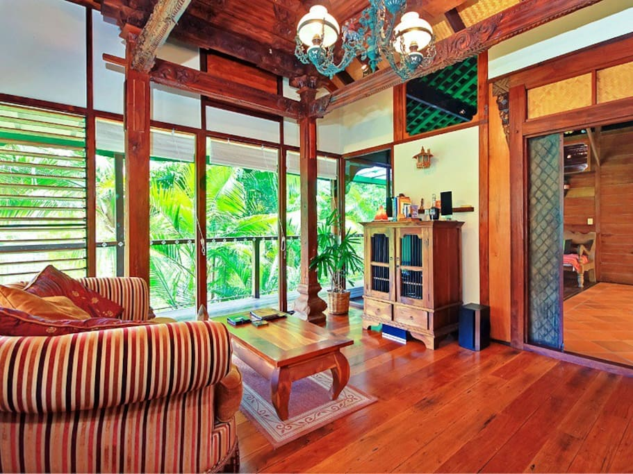 The Lounge With Carved Ceilings, Glass Walls & Balinese Fixtures