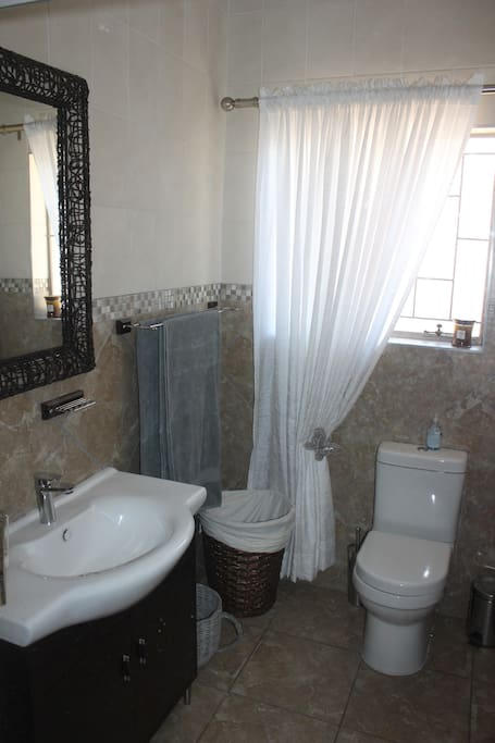 Private bathroom with ample storage.