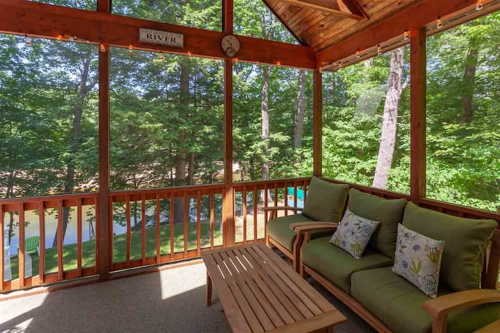 Screened-in porch over-looking the Saco River.