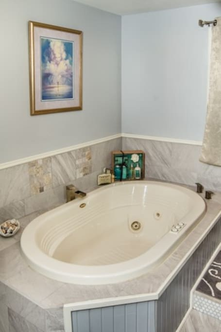 Large jetted tub in master bathroom.