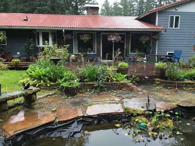 Koi pond and large deck with water view in hosts area