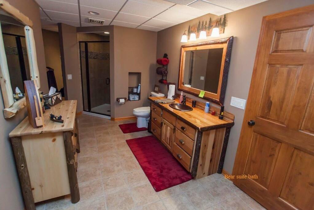 """""""Bear"""" bathroom with shower, closet, and dresser"""