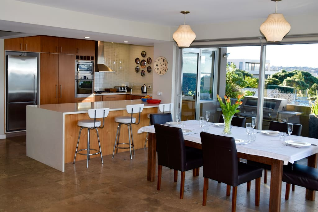 Enjoy the panoramic ocean views from our large open plan kitchen, dining, living room and outdoor entertainment area. With floor-to-ceiling windows the sun can be enjoyed inside or out throughout each day.