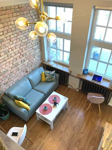 Overview of the living room. High ceilings , plenty of natural light. Apartment is distributed over 2 floors. Please note the second floor height is 130cm.