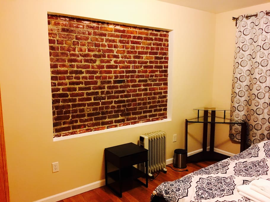 beautiful exposed brick wall with working desk