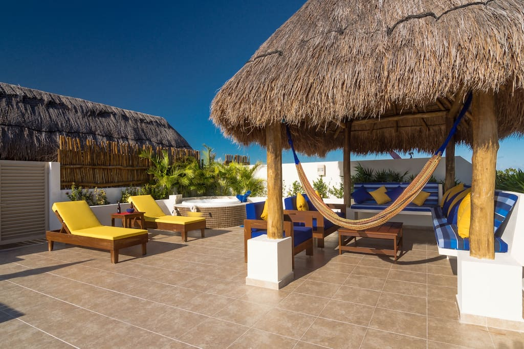 Main terrace with sunbeds, palapa and sitting area.