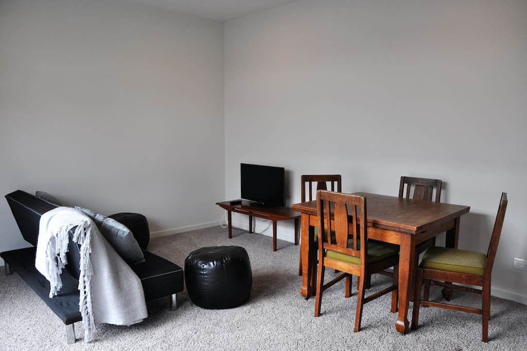 Spacious lounge and dining area with TV and free WIFI.