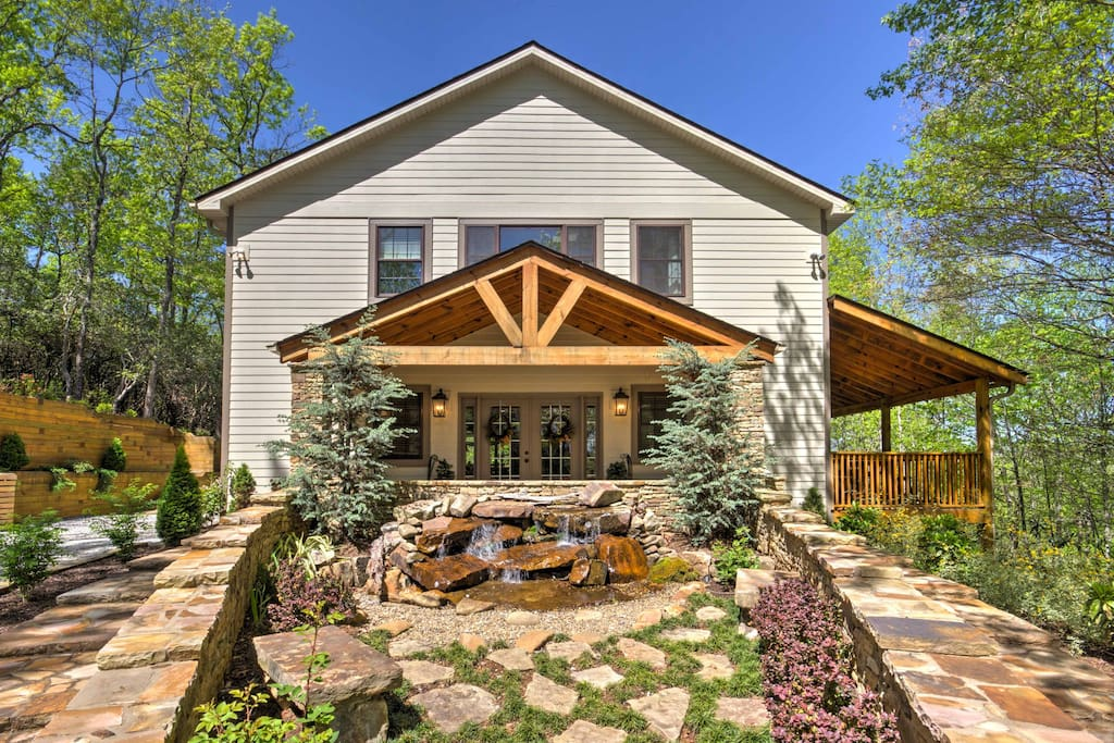 This splendid Forest Cove Getaways home boasts over 3,000 square-feet of living space and an expansive wrap-around deck equipped with a gas grill and hot tub.