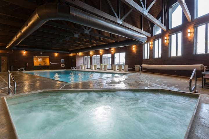 Large indoor heated pool and hot tub, with two hot tubs outside  as well.  A true treasure cherished by all after any kind of day!