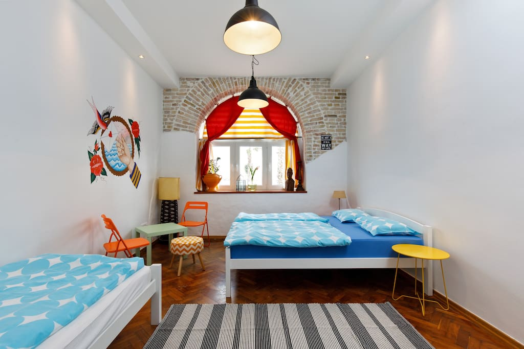 Room 1: spacious double bedroom + 1 single bed; a/c and wifi provided for free, wardrobe.