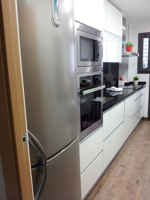 KITCHEN - Induction Cooker Dishwasher  Nespresso Coffe machine Fully equipped, with washing machine, microwave, fridge, oven, orange juicer, kettle, toaster, smoothie blender, etc.