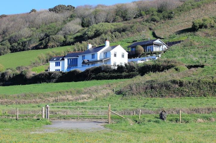 Our 6 bed house and 2 bed chalet are located on the headland, just a few minutes walk from the beach and less than 10 minutes walk from the village.