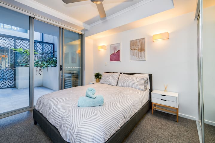 2nd bedroom with queen bed, deluxe mattress and private balcony access.