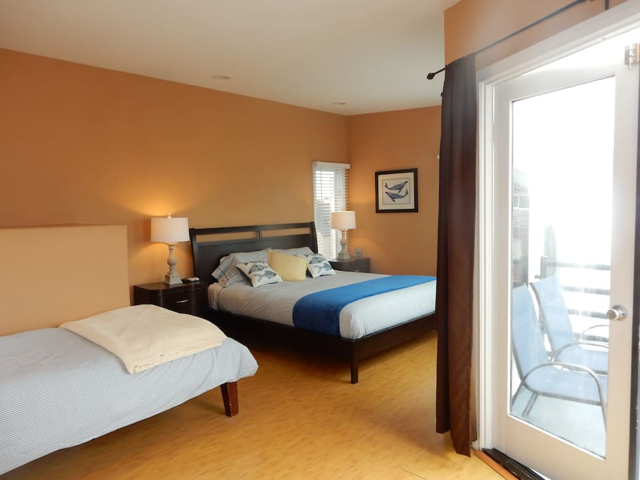Master suite w/ cal king, 2 twin beds, small and large balcony and full bathroom