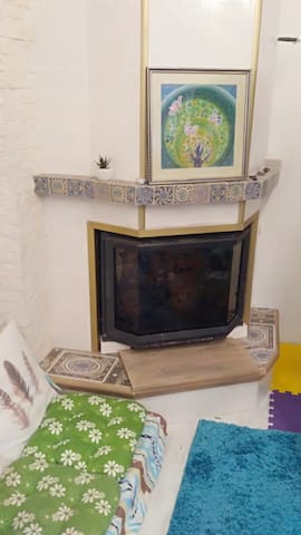 fireplace for cold season in the common Kitchen-Studio with a resting zone