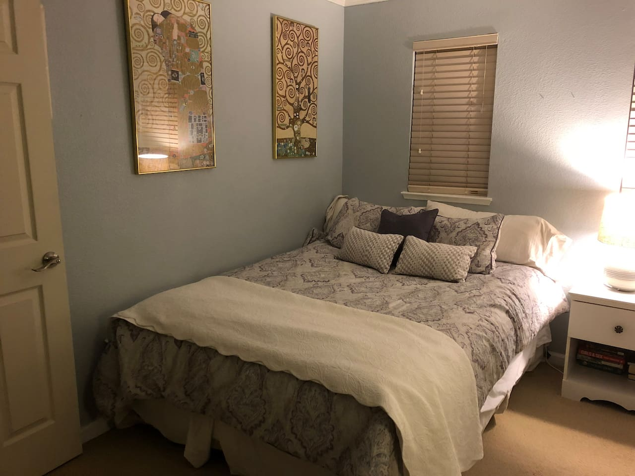 Extra Long comfy queen size bed. Side table and lamp for reading.