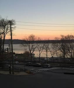 Sunset river views with large balcony. - Dobbs Ferry