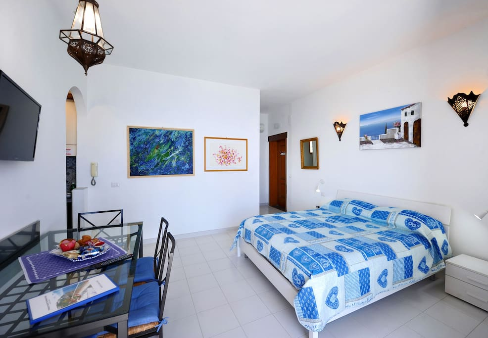 Living/double bed room (BED SIZE 170 X 200 CM).
