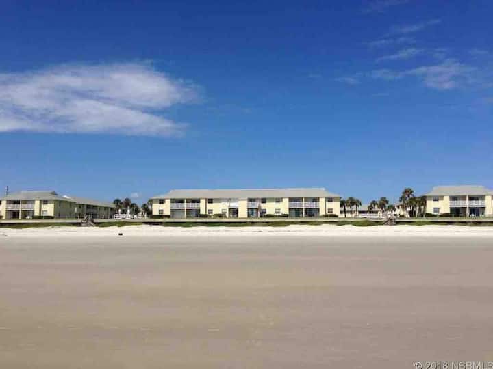 Beach condo with heated oceanfront pool