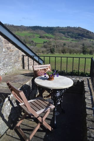 The balcony with views of the mountains - a perfect spot for breakfast or an evening drink