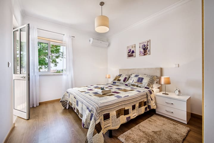 The master bedoom has a wonderful large kingsize bed and access to a small terrace
