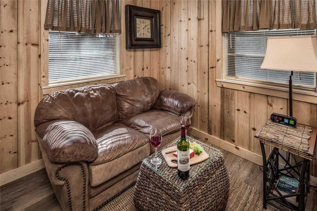 An sitting area in this studio cabin is perfect for catching up on a book or resting in between meals!