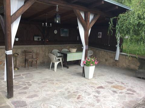 House with pergola and playground