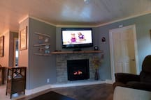 HD TV W/Netflix & Sat. over Fireplace