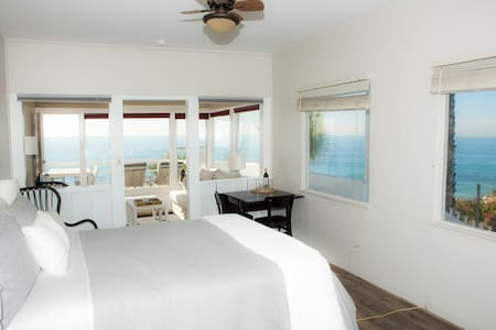 Enjoy this dreamy retreat with a personal ocean view from the bedside windows