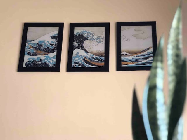 A triptych of Hokusai's The Great Wave off Kanagawa