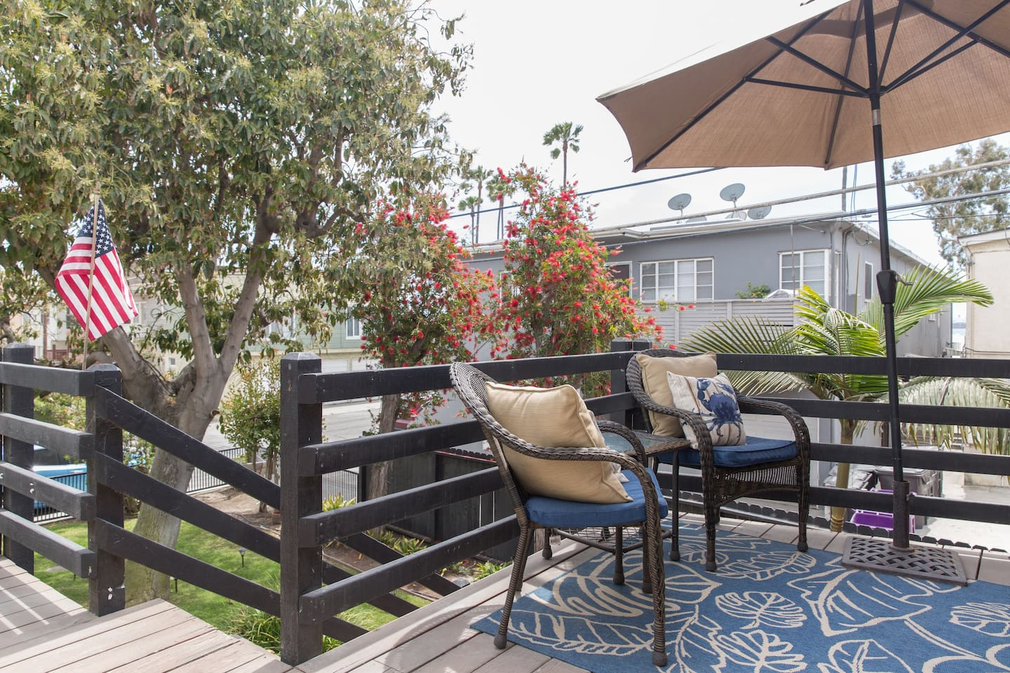 Relaxing private patio with peekaboo ocean view!