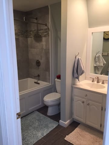 Full Bath just remodeled, luxury shower head, full deep soaking tub. Full soaking tub.  Double sink. Shared between guest room and 2 kid rooms.