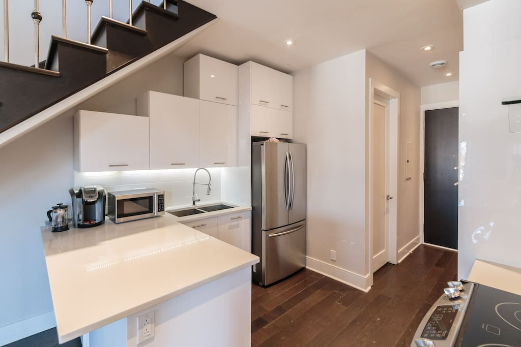 Beautiful fully equipped kitchen with stainless steel appliances