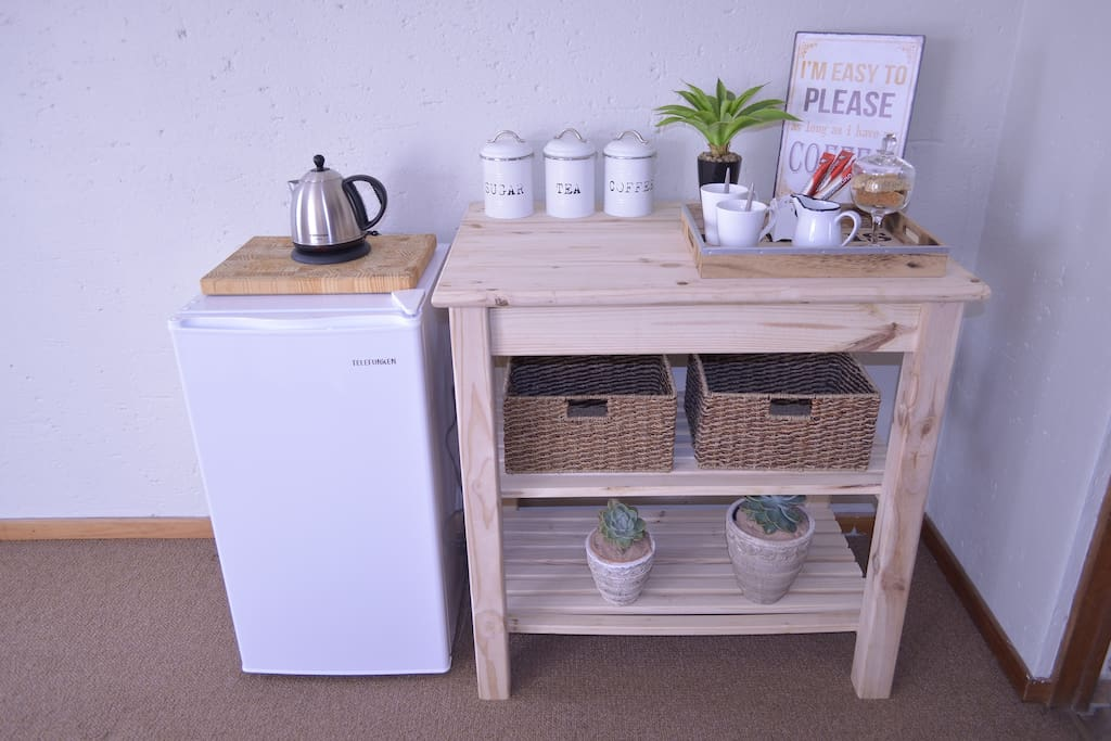 Bedroom 2: Coffee station with fridge & kettle
