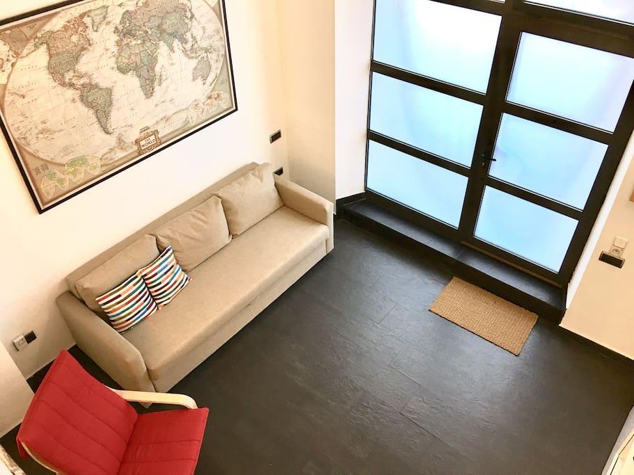 Entrance and big sofa bed