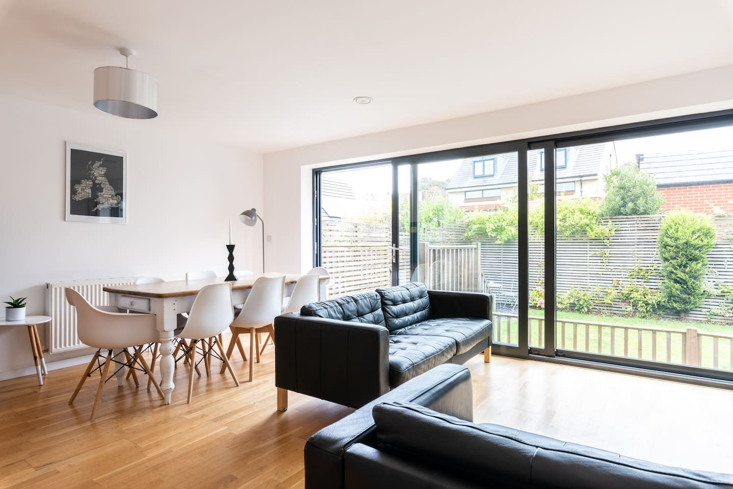 Large open plan living space with direct access to private garden/terrace, 2 x large leather sofas, table seating for up to 8 x guests.