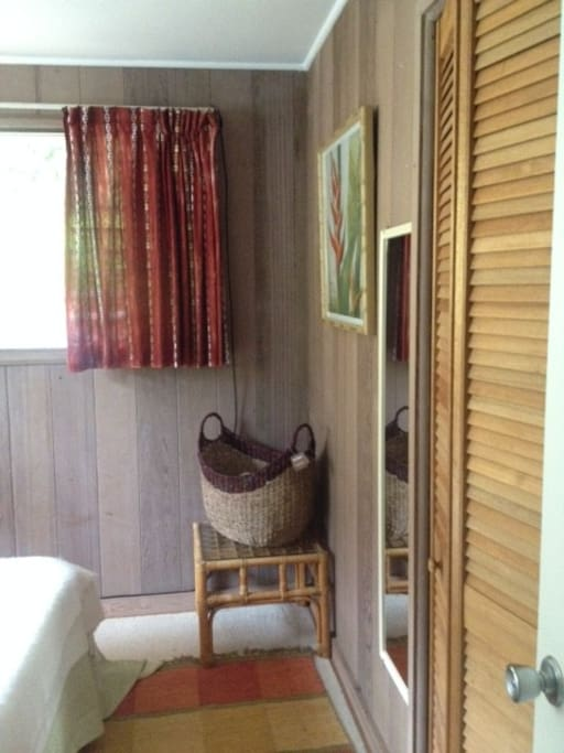 Closet to hang your clothes and Basket with Towels, extra Coverlet.