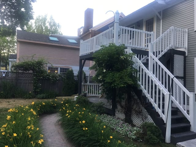 Summer view of the walkway.  This unit is on the ground floor.