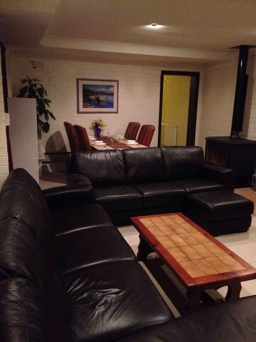 Spacious living/dining area with plenty of room to stretch out on the leather lounges.
