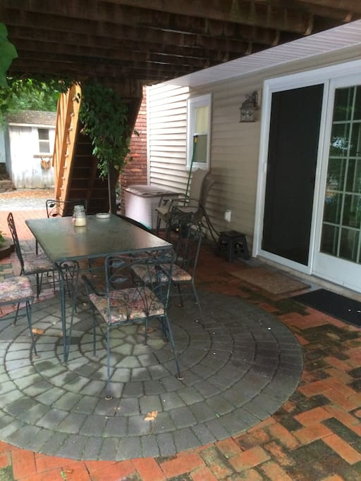 Sliding French Doors and Patio area at the entrance to your space. You can relax  and talk in this space  at your leisure. Warmer months available. Winter months covered.