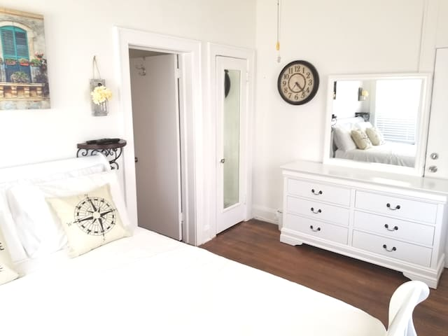 Beautiful and cozy bedroom with a queen size bed and smart TV, as well as brand new furniture