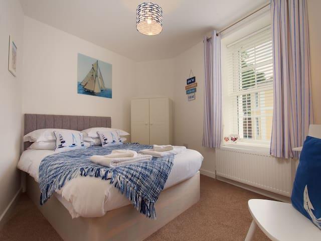 First floor coastal themed bedroom