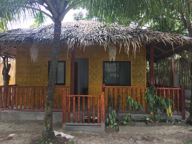 The Yellow Beach Hut