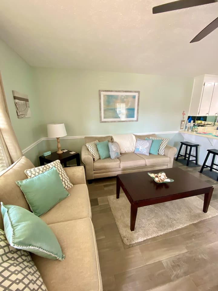 ★ Stylish, Inviting Condo Steps from the Beach ★